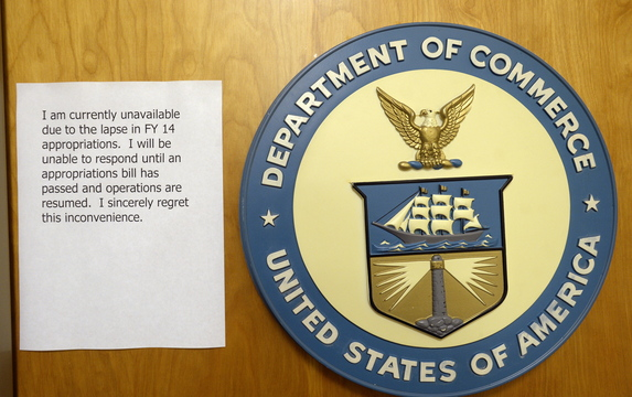 The Department of Commerce in Portland sits closed with a note apologizing for the inconvenience Friday.