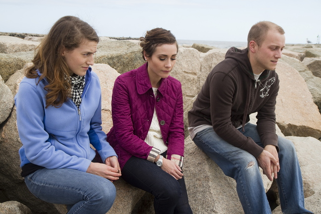 Siblings Sydney, Morgan and Isaiah Mosher, whose father committed suicide a dozen years ago, reflect on the loss before a fundraiser they were hosting at Wells Beach on Sunday. They are raising funds for Camp Kita, which will bring children of suicidal parents together for a week in the summer.