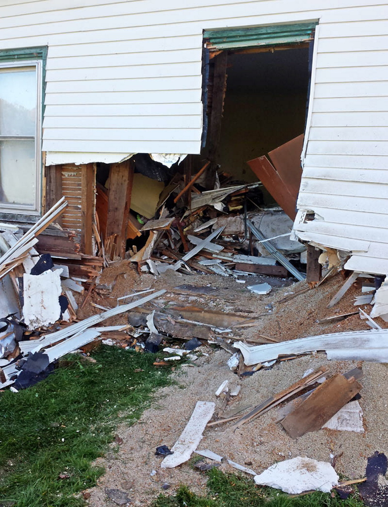 An Oldsmobile crashed through a wall into this home on Knowles Road in Belgrade on Thursday night.