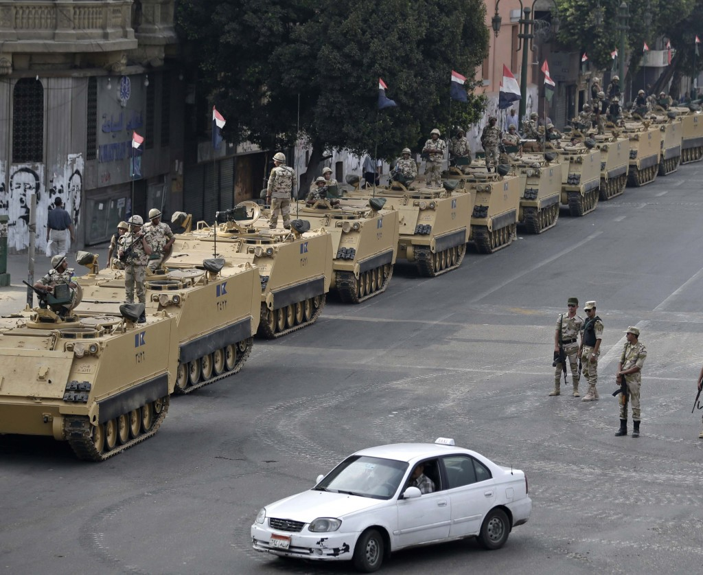 Egyptian army soldiers take their positions to guard an entrance of Tahrir Square in Cairo on Aug. 16. Since the July 3 coup, hundreds of pro-Morsi protesters have been killed.
