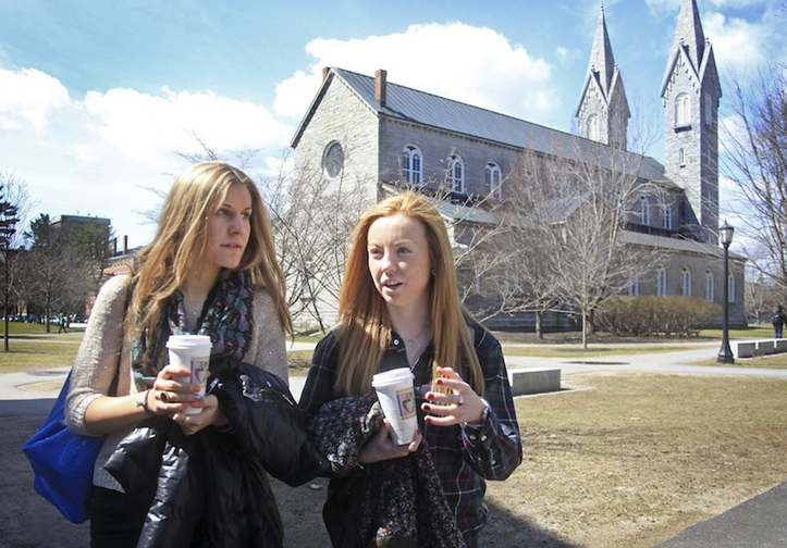 In this April 2013 file photo, freshmen Nina Hadzibabic of Long Island, CT, left, and Leah McDonough of Boston, Mass., on the Bowdoin College campus in Brunswick, Along with best food, Bowdoin College ranked 2nd for quality of life, best science facilities and best administration, in the Princeton Review's most-recent college rankings. It also ranked 4th for best dorms and 10th for happiest students.