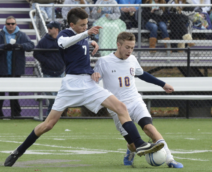 Luther Williams, left, of Westbrook and James Biegel of Cheverus contend for the ball Saturday during Cheverus' 1-0 victory in a Western Class A boys' soccer prelim.