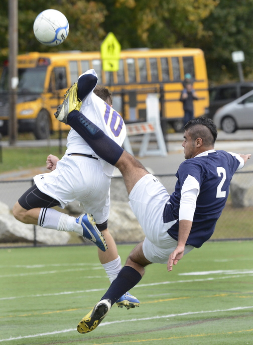 Mohammed Al Kinani of Westbrook kicks the ball past James Biegel of Cheverus, which will play at Noble in the quarterfinals Wednesday.