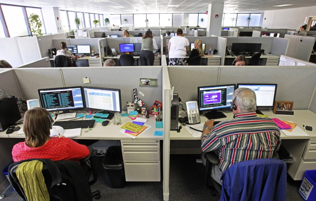 Workers at the Vermont Health Connect call center in Burlington, Vt., talk to customers on Oct. 1. Gov. Peter Shumlin said recently that the Vermont Health Connect health insurance marketplace's performance is improving.