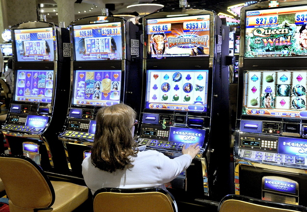 A patron plays the slot machines at Hollywood Casino in Bangor in 2012. A commission established to analyze the impact of gaming in Maine and chart a path forward is cutting short that effort.