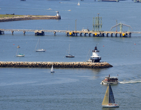 Spring Point Ledge Light, foreground, and Bug Light, rear center, stand on either side of the oil pipeline in South Portland. On Nov. 5, South Portland voters will decide whether the city should restrict new development of petroleum-related industry on its waterfront.