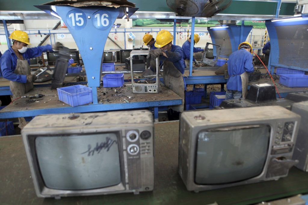 Television sets await recycling at a workshop in an environmental technology company in Zhuzhou in southern China's Hunan province. Environmentalists have long complained that China's recycling industry is poisoning the air, water and soil.