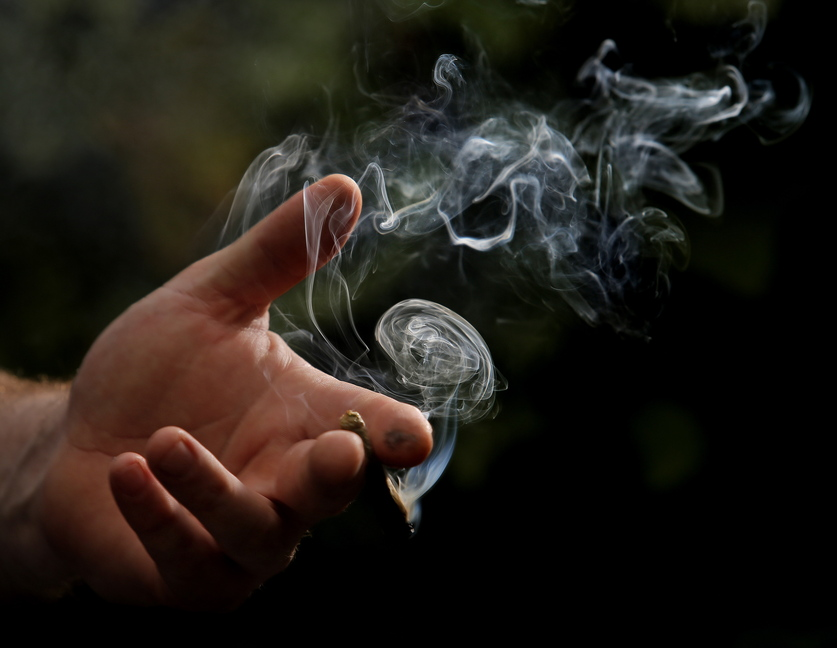 Smoke billows from a marijuana cigarette in Portland last week. On Nov. 5, the city will vote on a citizen-led referendum to enact an ordinance to legalize recreational marijuana for adults over the age of 21. There will still be no legal way for people to obtain marijuana.