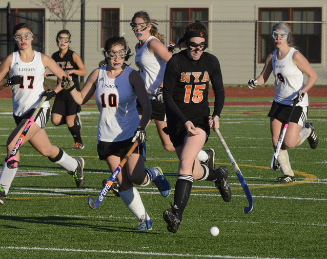 John Patriquin/StaffPhotographer Lisbon's Jennifer Smith chases the ball with NYA's Olivia Madore as North Yarmouth Academy and Lisbon play for the Western Class C field hockey championship at Thornton Academy in Saco. NYA won the game, 2-1.