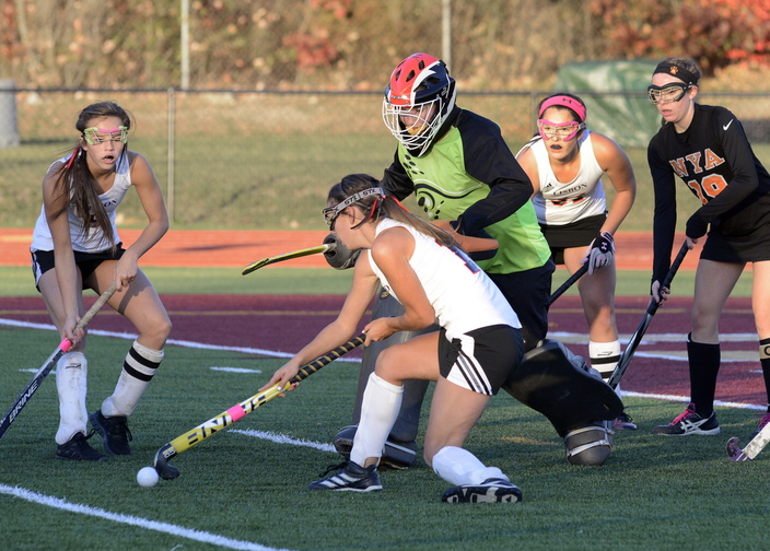John Patriquin/StaffPhotographer Lisbon's #13 Hannah Jordan tries to score against NYA's goalkeeper Elizabeth Coughlin as North Yarmouth Academy and Lisbon play for the Western Class C field hockey championship at Thornton Academy in Sacoon Wednesday. NYA won the game, 2-1.