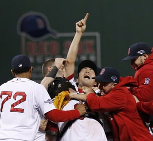 Red Sox closer Koji Uehara, center, celebrates with teammates after a 5-2 win Saturday over the Detroit Tigers clinched the American League Championship Series.