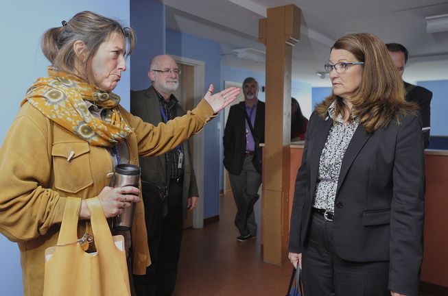 Barbara Poppe, right, executive director of the U.S. Interagency Council on Homelessness, listens to Preble Street's Donna Yellen, left, during a visit to Portland's Kreisler Teen Shelter on Tuesday.