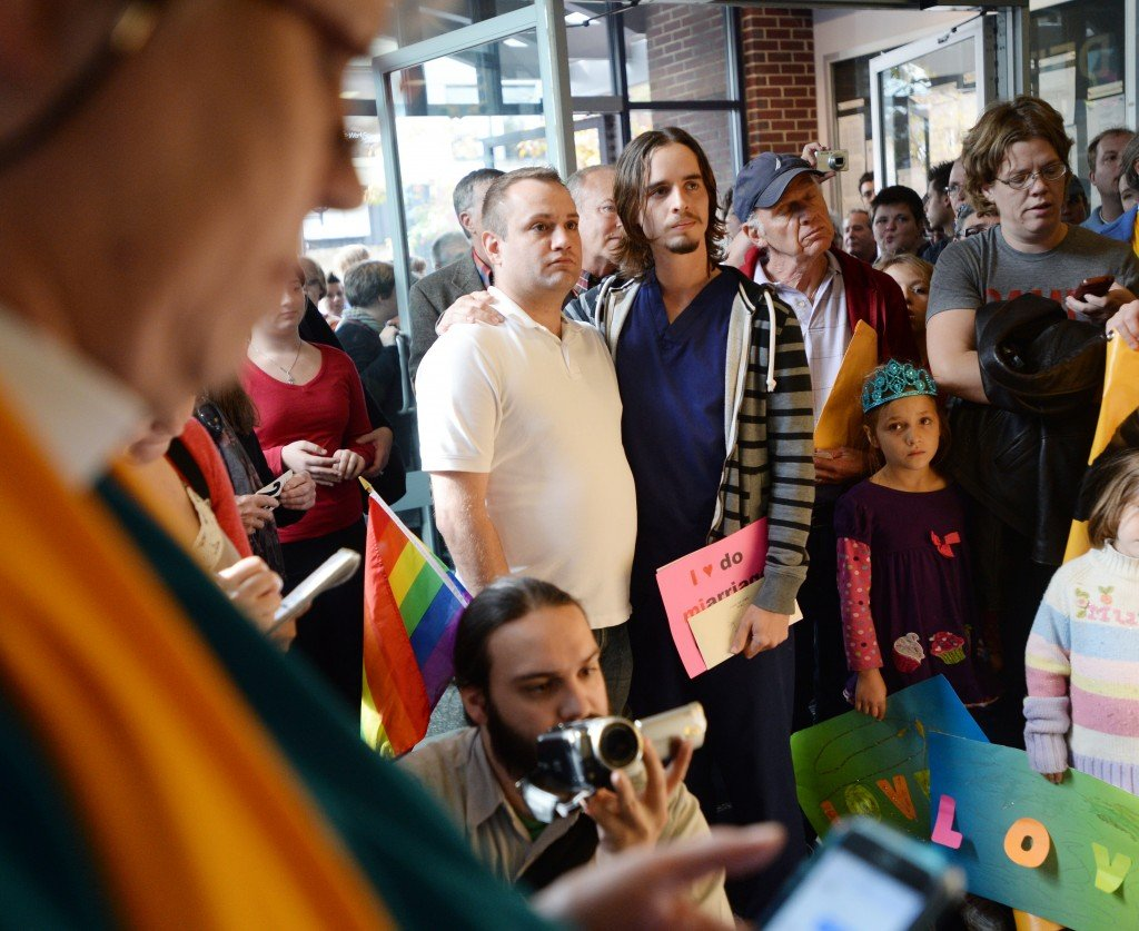 Same-sex marriage supporters in Ann Arbor, Mich., learn Wednesday that a decision that could have overturned the state's ban on same-sex marriage was postponed.