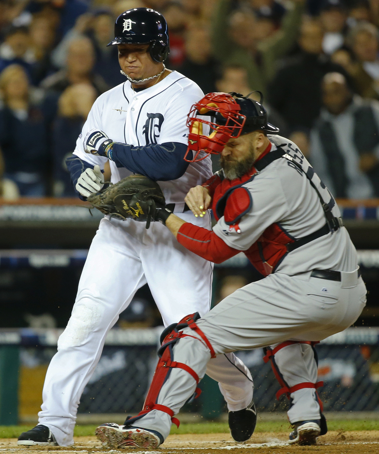 Miguel Cabrera of the Detroit Tigers is tagged out at home by Boston catcher David Ross in the first inning of Game 5. The Red Sox moved into a 3-2 series lead.