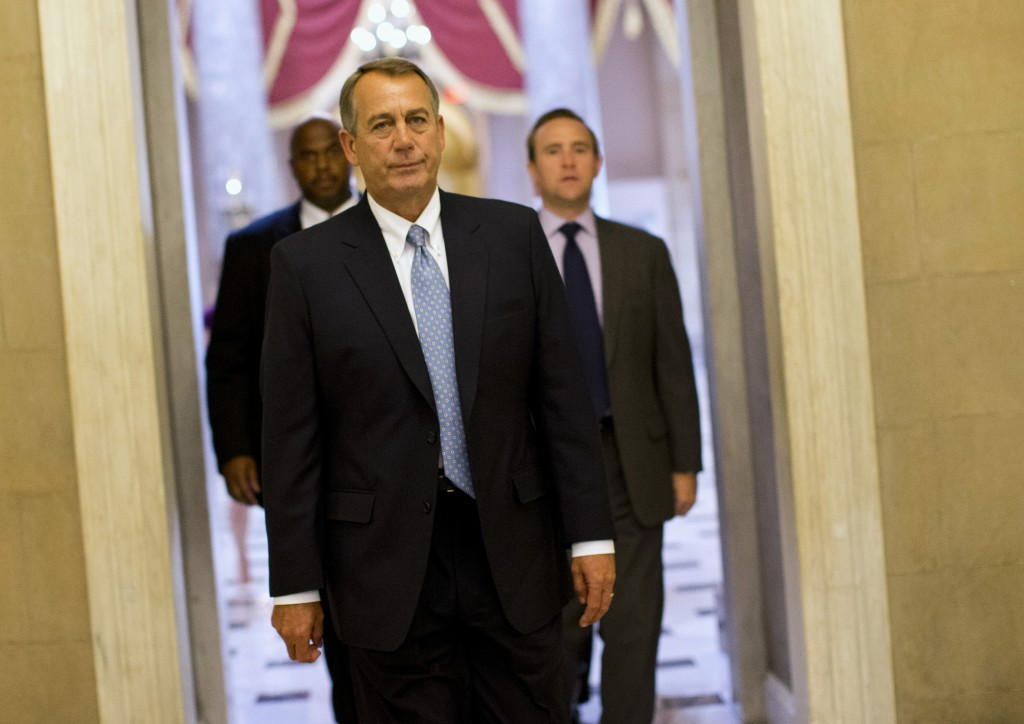 House Speaker John Boehner of Ohio walks to his office on Capitol Hill in Washington, Wednesday, Oct. 2, 2013. The Republican-run House has rejected an effort by Democrats to force a quick end to the partial government shutdown. By a 227-197 vote Wednesday, the House rejected a move by Democrats aimed at forcing the House to vote on immediately reopening the government without clamping any restrictions on President Barack Obama's health care law.