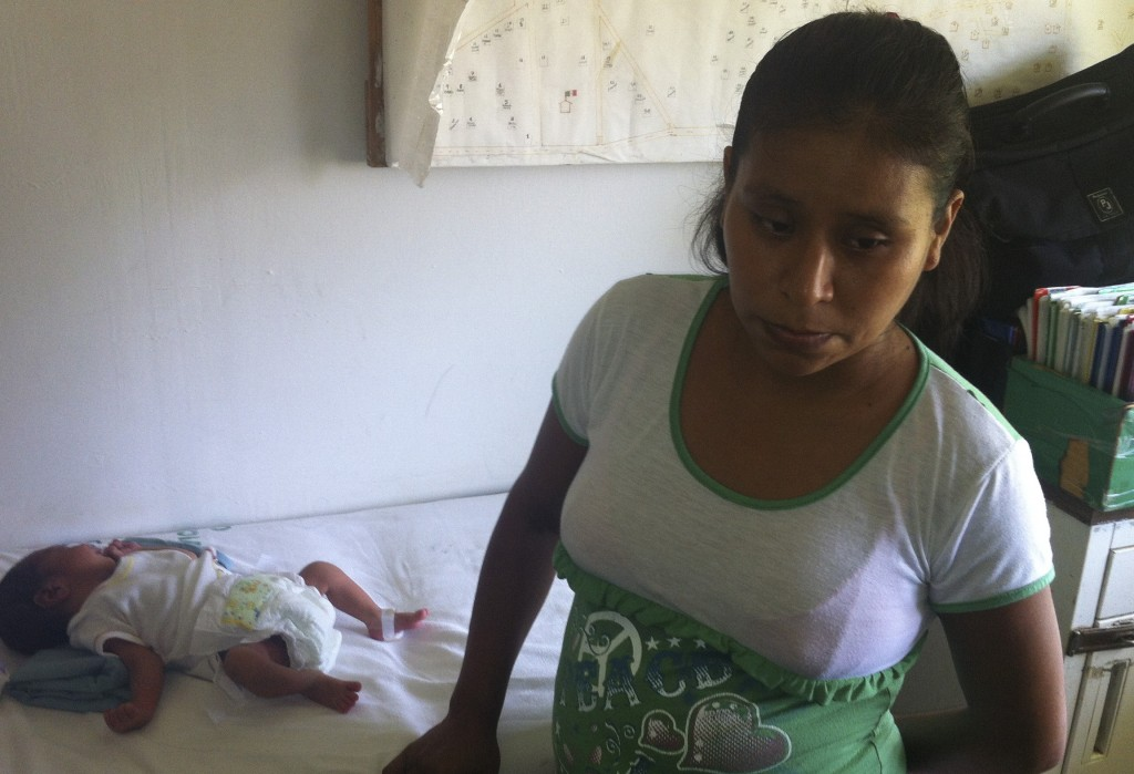 Irma Lopez stands near her son Salvador at a clinic in Jalapa de Diaz, Mexico. A nurse had refused to let Lopez enter the clinic a few days earlier, forcing her to give birth on the lawn.