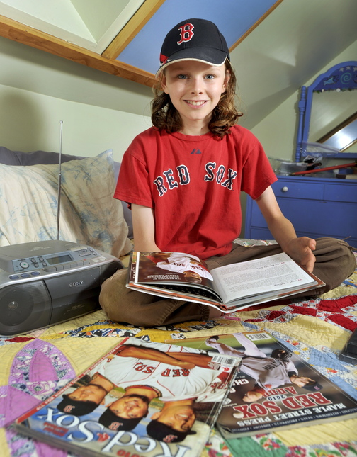 Finn Dierks-Brown, 12, says the Red Sox don't lose when he listens to WEEI broadcasts, and hopes the team won't be jinxed by ESPN Radio coverage of the World Series.