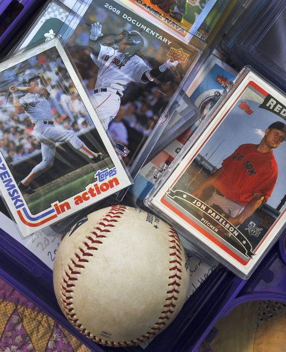 Red Sox memorabilia aplenty decorates 12-year-old Finn Dierks-Brown's room in North Yarmouth, who says his young imagination has been furthered by listening to his favorite team on Boston's WEEI, which won't be heard in his town during the World Series.