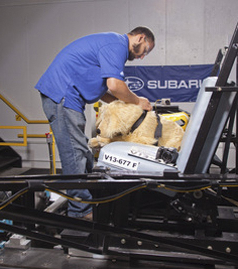 MGA Research Corp. staff prep a crash-test dog dummy for testing. All the dummy dogs used to test dog restraint harnesses for the Center for Pet Safety make up a team of what is believed to be the nation's first instrumented, weighted and correct canine prototypes.