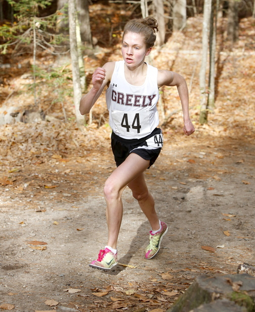 Kristin Sandreuter of Greely runs up a hill on her way to capturing the Western Class B cross country regionals at Twin Brook by almost a minute and a half.