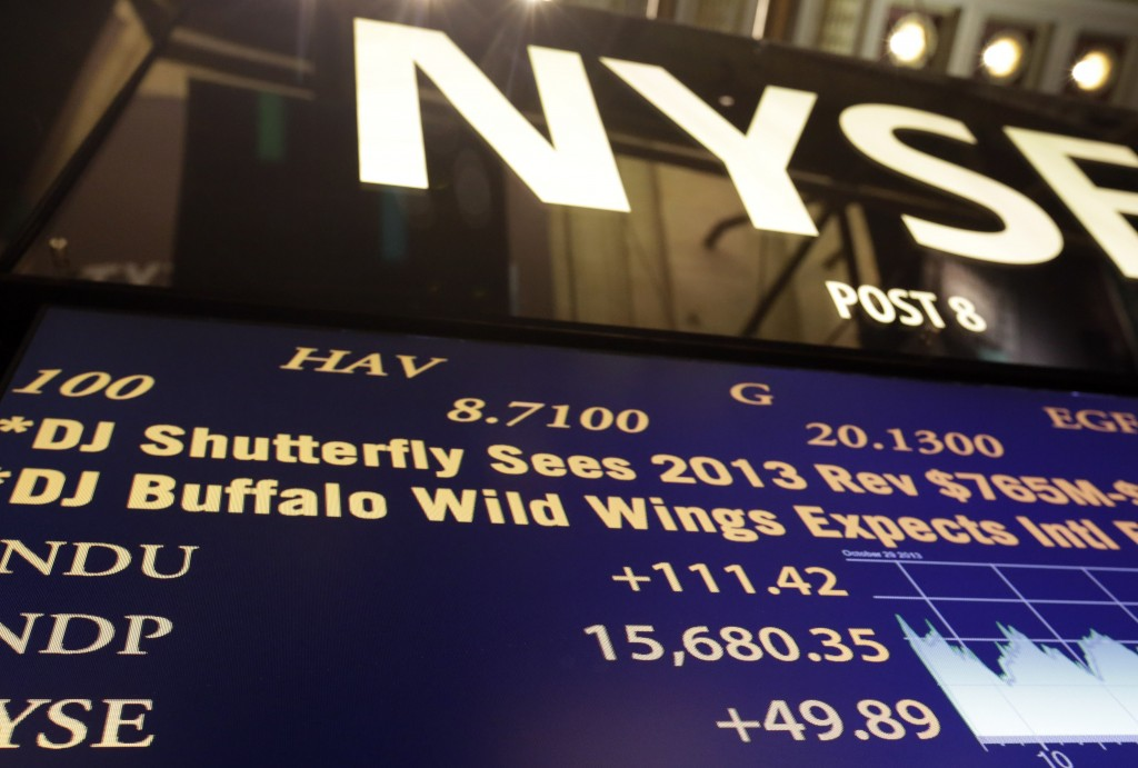 A board on the floor of the New York Stock Exchange shows Tuesday's record-high closing number – 15,680.35 – for the Dow Jones industrial average.