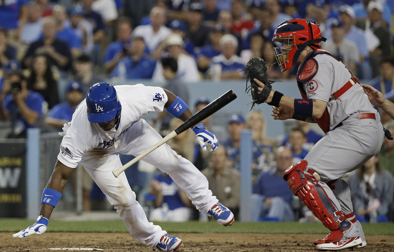 Yasiel Puig of the Los Angeles Dodgers gets out of the way of an inside pitch Tuesday night as catcher Yadier Molina of the St. Louis Cardinals receives the ball in the fourth inning of the Cardinals' 4-2 victory in Game 4.