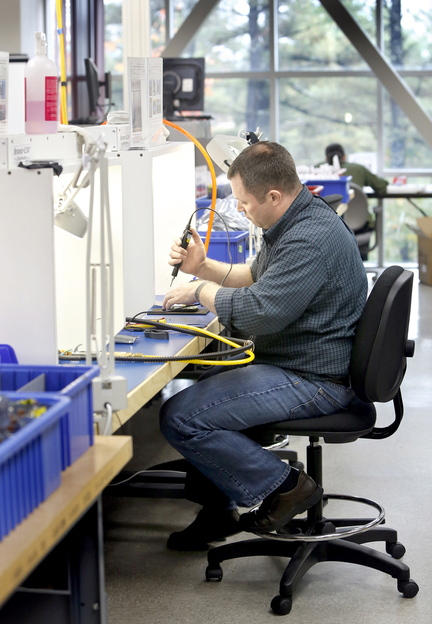Jon McPherson assembles an inReach SE in the manufacturing center at DeLorme in Yarmouth.