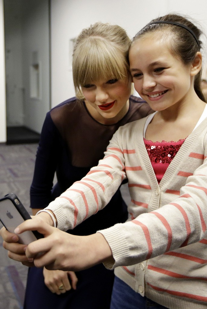 Taylor Swift poses for a photo with Piper Moralez, 11, at the Country Music Hall of Fame and Museum on Saturday in Nashville, Tenn. Swift was thereto open the $4 million Taylor Swift Education Center.