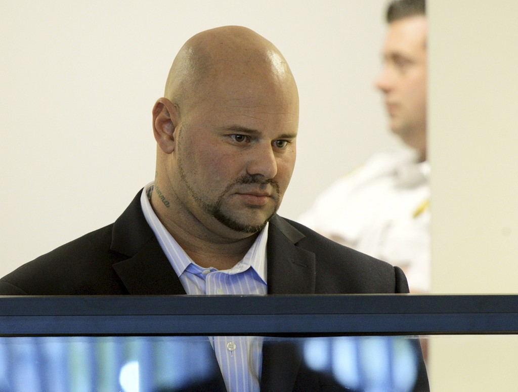 Jared Remy, son of Boston Red Sox broadcaster Jerry Remy, appears at his arraignment on Oct. 8, 2013, at Middlesex Superior Court in Woburn, Mass., on murder and assault charges in the death of his girlfriend Jennifer Martel.
