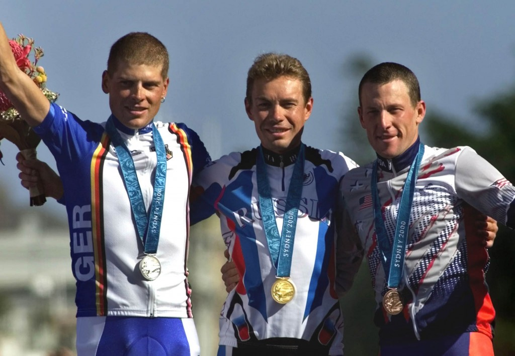 Bronze medal winner Lance Armstrong, right, is shown with Germany's silver medal winner Jan Ullrich, left, and Russia's Viacheslav Ekimov, winner of the gold medal, in the men's individual time trial in Sydney during the 2000 summer Olympics. The International Olympic Committee stripped Armstrong of the medal after he admitted to doping.