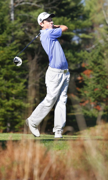 Chris Billings of Cheverus watches a tee shot during the high school individual state golf championships Saturday. Billings tied for first place in Class A with a 75.