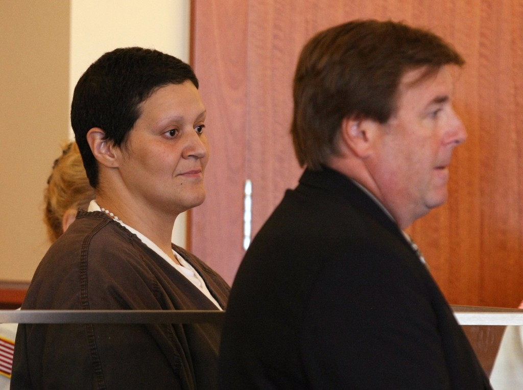 Tanya Singleton, left, and her attorney Peter Parker, appear in Fall River Superior Court on Sept. 30, 2013. Singleton, a cousin of former New England Patriots tight end Aaron Hernandez pleaded not guilty to a conspiracy charge for her alleged actions following the killing of Hernandez's friend.