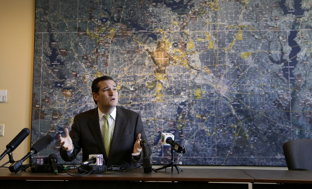 Sen. Ted Cruz, R-Texas, responds to questions from reporters at the Fort Worth, Texas, Chamber of Commerce office after he participated in a small-business roundtable meeting with area business representatives Tuesday.