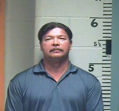 Charles Fourcloud, former finance director of the Passamaquoddy tribe's Pleasant Point Reservation, in a police booking photo after police arrested him Sept. 23, 2013, in the tribal government parking lot for driving under a suspended California license.