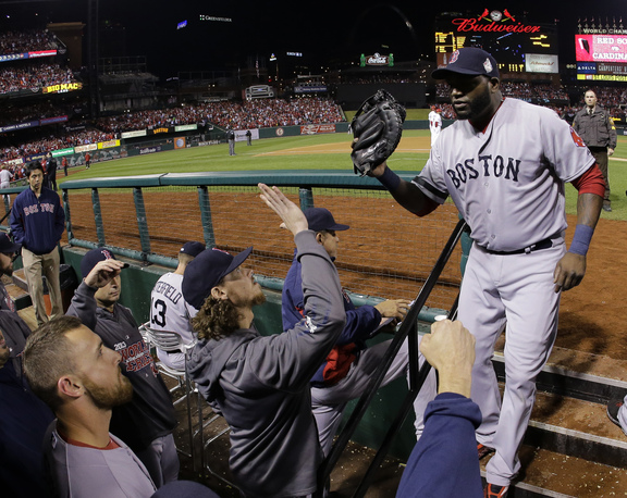 Boston Red Sox designated hitter David Ortiz, right, is greeted in the dugout after being pulled from the game during the eighth inning of Game 5 of baseball's World Series against the St. Louis Cardinals Monday, Oct. 28, 2013, in St. Louis. The Red Sox won 3-1 to take a 3-2 lead in the series.