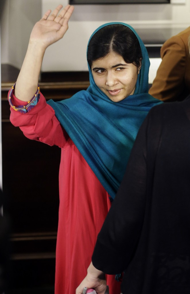 Malala Yousafzai waves to the media after posing for photographs on Thursday in New York. Yousafzai, who was shot by the Taliban for her advocating education for girls, has won the $65,000 Sakharov Award, Europe's top human rights award.