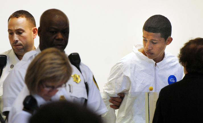 Philip Chism, 14, stands during his arraignment for the death of Danvers High School teacher Colleen Ritzer in Salem District Court in Salem, Mass., on Wednesday. Chism has been ordered held without bail.
