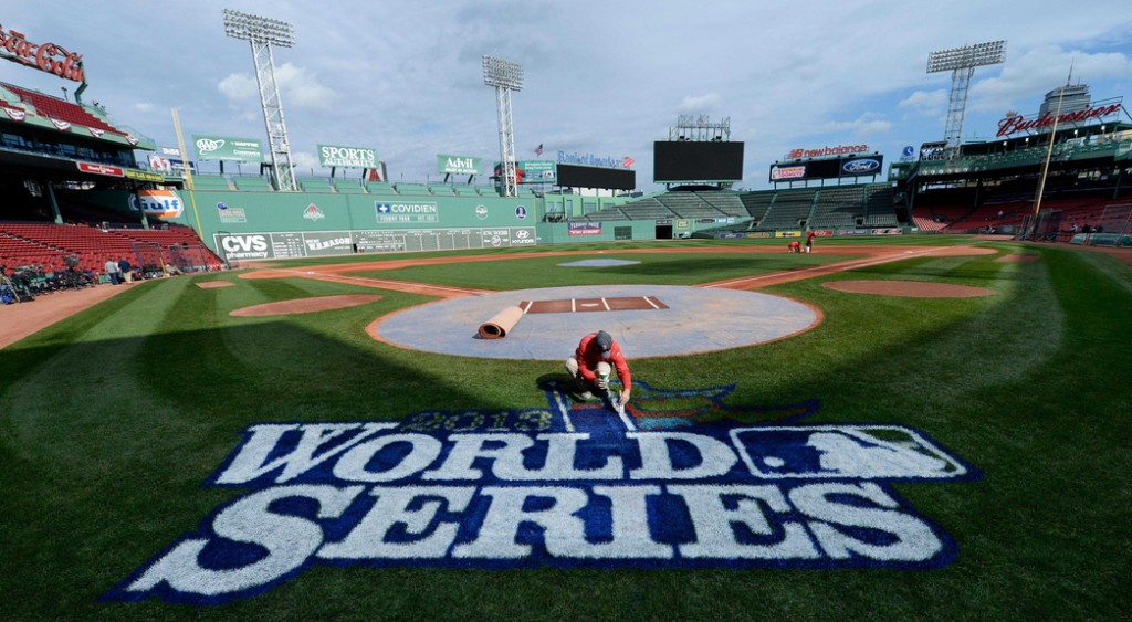 Chris Williams paints the logo Tuesday on the eve of Game 1 of the World Series at Fenway Park, weather permitting. It will be the fourth Series appearance in 10 years for the Cardinals, and the third for the Red Sox.
