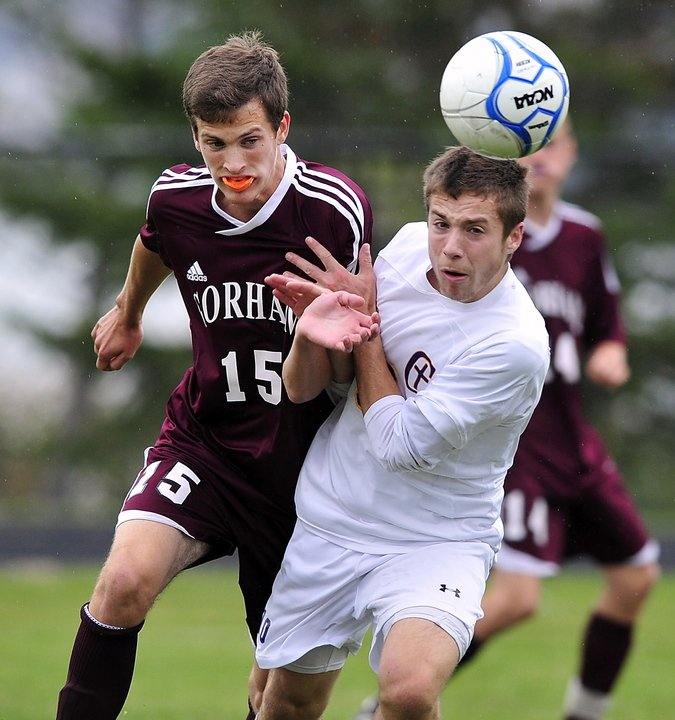 James Biegel of Cheverus, right, heads the ball away from Austin Bell of Gorham at Cheverus High. Gorham will bring a 10-3-1 record into the Western Class A playoffs. Cheverus dropped to 9-4-1.