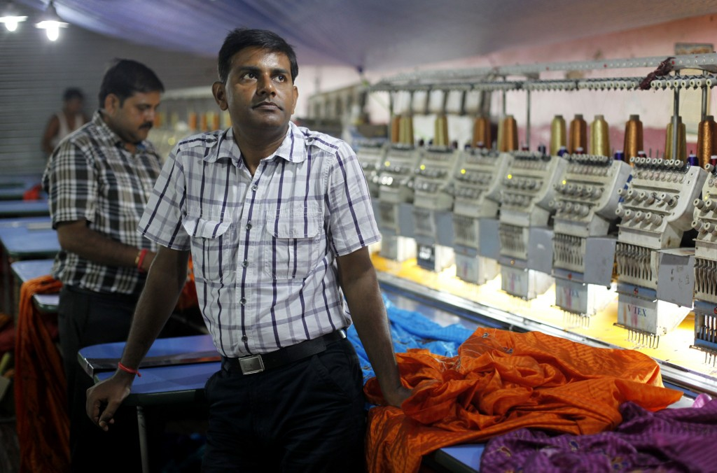 Pradeep Kumar Yadav stands inside his embroidery factory in Varanasi, India, recently. Despite nearly two decades of rapid economic growth, most Indians are risk averse and do not own stocks.