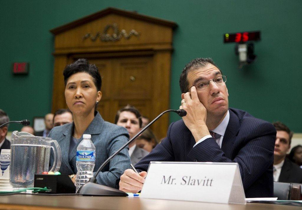Cheryl Campbell, senior vice president of CGI listens at left as Andy Slavitt, representing QSSI's parent company, testifies on Capitol Hill Thursday before the House Energy and Commerce Committee hearing with contractors that built the federal government's health care websites. The contractors responsible for building the troubled HealthCare.gov website say it was the government's responsibility – not theirs – to test it and make sure it worked.