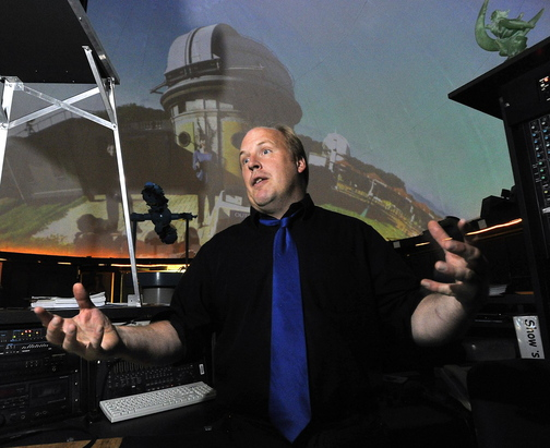 Edward Gleason, manager of the Southworth Planetarium at USM, talks last month about the proposal to eliminate the physics major at USM and its effect on the planetarium.