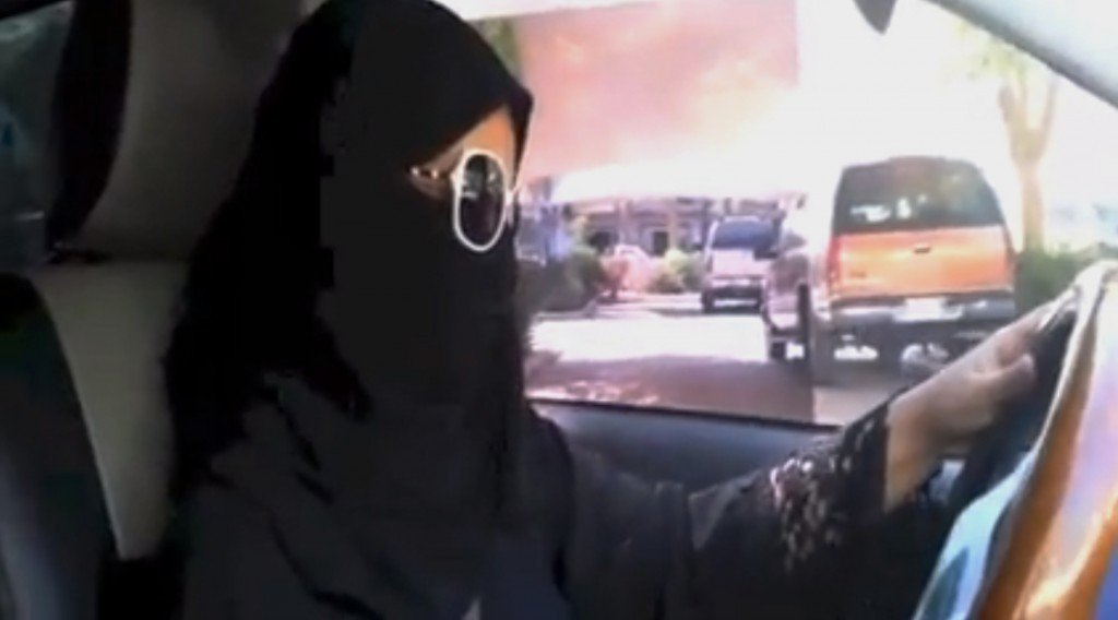 In this image made from video provided by theOct26thDriving campaign, which has been authenticated based on its contents and other AP reporting, a Saudi woman drives a vehicle in Riyadh, Saudi Arabia on Saturday. A Saudi woman said she got behind the wheel Saturday and drove to the grocery store without being stopped or harassed by police, kicking off a campaign protesting the ban on women driving in the ultraconservative kingdom.