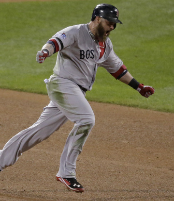 Jonny Gomes celebrates after hitting a tiebreaking three-run homer in the sixth inning Sunday night, lifting the Red Sox to a 4-2 win over the Cardinals in Game 4 of the World Series.