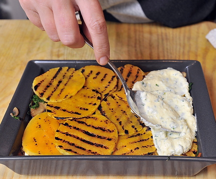 Rudalevige spoons a ricotta cheese and herb mixture, left, over grilled butternut squash for her lasagna.
