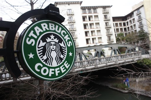 A sign outside a Starbucks hangs over the Riverwalk in San Antonio, Texas. The world's biggest coffee chain said Thursday that it will ask customers and businesses to sign a petition calling for an end to the partial government shutdown that has forced hundreds of thousands of federal workers off the job.