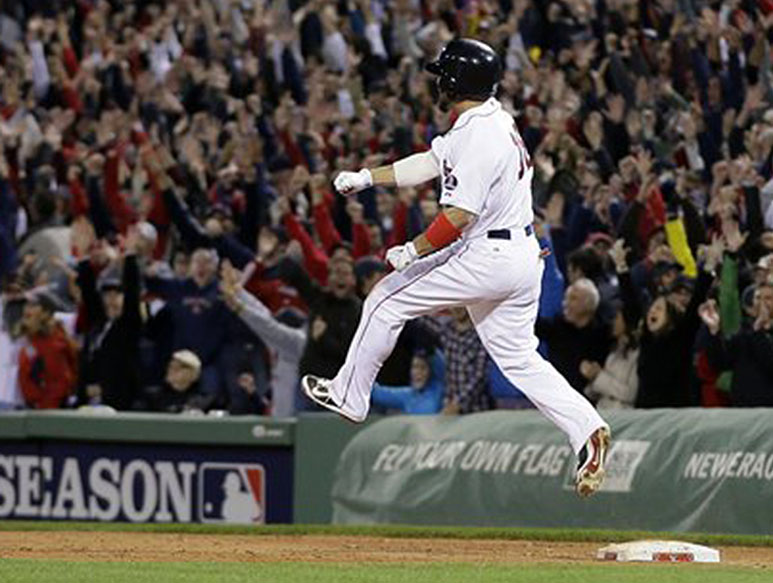 Red Sox right fielder Shane Victorino celebrates his grand slam against the Detroit Tigers as he rounds first base in the seventh inning of Game 6 of the American League Championship Series on Saturday at Fenway Park.