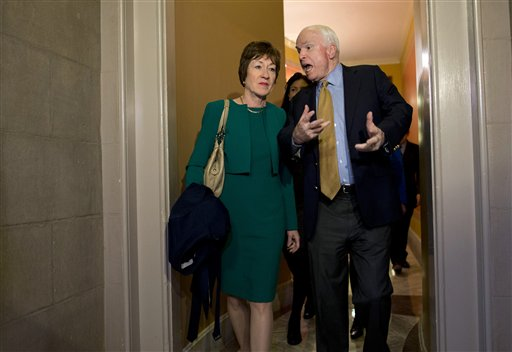 Sen. John McCain, R-Ariz., right, talks with Sen. Susan Collins, R-Maine, after arriving on Capitol Hill in Washington, Friday, Oct. 11, following after a meeting between Republican senators and President Obama at the White House on the ongoing budget battle. (AP Photo/ Evan Vucci)
