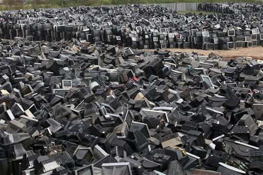 Discarded television sets pile up in a scrap yard awaiting recycling in Zhuzhou city in south China's Hunan province.