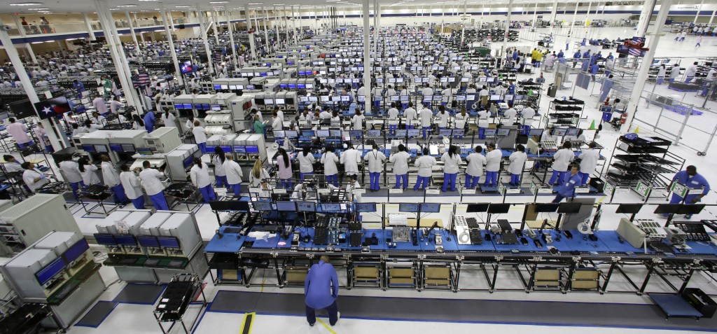 Employees work at the Motorola smartphone plant in Fort Worth, Texas, last month. The plant is the only U.S. factory making mobile phones.
